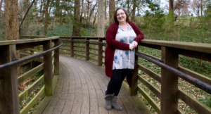 Paige Manion, Clinical Supervisor, full body photograph standing on a path in the woods